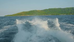 Water surface behind of fast moving motor boat, island Seychelles stock video footage