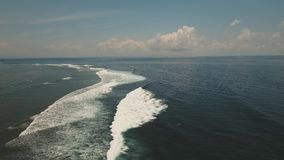 Water surface with big waves, aerial view.Bali. Aerial view: Sea water surface with big waves. Flying over the blue ocean with blue water. Bali,Indonesia.4K stock footage