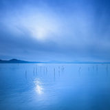 Water surface in a blue morning on the Trasimeno lake, Italy. Hi Stock Photos
