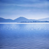 Water surface in a blue morning on the Trasimeno lake, Italy. Hi Royalty Free Stock Image
