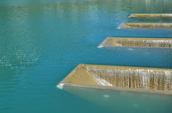 Water surface with fillers by artificial pouring Royalty Free Stock Image