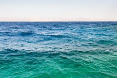 Water surface of Gulf of Aqaba on Red Sea. Travel to Middle East country Kingdom of Jordan - water surface of Gulf of Aqaba on Red Sea in winter morning Stock Photos