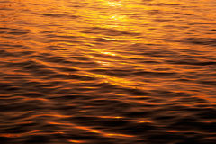 Water surface in the light of  setting sun Stock Photo