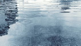 Water surface with ripples and sunlight reflections Stock Photo