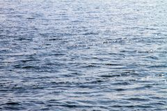 Water surface of the river with waves and sunlight reflections Royalty Free Stock Photos