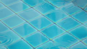 Water surface of swimming pool at rain. stock footage