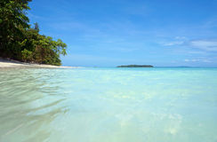 Water surface and tropical beach with an island Stock Photo