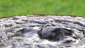 Water surges out from a concrete bucket like a spring. Close up stock video