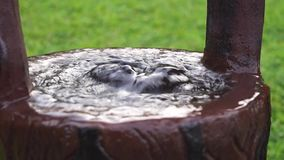 Water surges out from a concrete bucket like a spring. Close up stock video footage