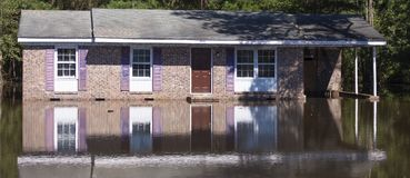 Water surrounding a house in North Carolina after Hurricane Flor. Wagram, North Carolina, United States/September 18, 2018: Flood waters backing up on a bridge stock image