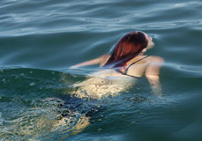 Water swim dive. Swimming girl in fresh cold water coming Royalty Free Stock Photography
