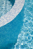 Water in the swimming pool. Clear blue water in the swimming pool Royalty Free Stock Photography