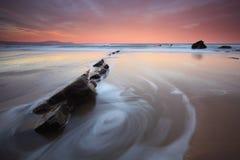 Water swirl in Barrika beach Royalty Free Stock Image