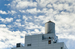 Water Tank against Cloudy Sky Stock Photography