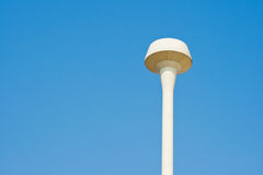 Water tank. On blue sky background Stock Photo