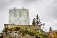Water Tank and Cloudy Sky Stock Photo