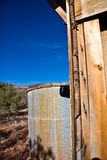 Water tank in desert  Stock Images