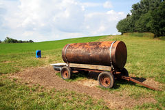 Water tank in a field Royalty Free Stock Photo