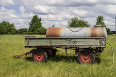 Water Tank. Field - trees on horizon - cloudy sky Stock Images
