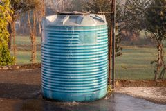 Water tank overflowing, fitted in house stock photography