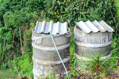 Water tank for plumbing system from cataract in forest Stock Photography