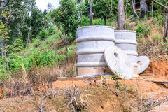 Water tank for plumbing system from cataract in forest Royalty Free Stock Photos