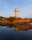 Water Tank Reflectio-Sunset Outer Banks Sunset-Duck NC. The water tank in the town of Duck, on the Outer Banks of North Carolina stands prominently among the Stock Image