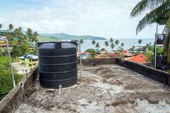 Water tank on the roof in Asia Stock Image