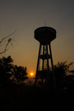 Water tank with silhouette, sunset Royalty Free Stock Photos