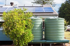 Water tank and solar panels. On house Royalty Free Stock Photos