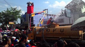 Water tank to spray into the crowd marches in Sukoharjo Stock Photo