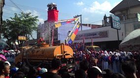 Water tank to spray into the crowd marches in Sukoharjo Stock Photos