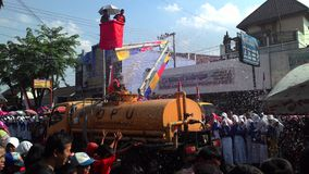 Water tank to spray into the crowd marches in Sukoharjo Royalty Free Stock Photo