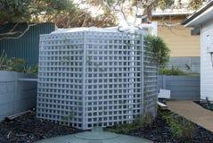 Water tank. An urban water tank in the backyard Royalty Free Stock Image