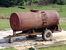Water Tanker. Old rusted abandoned water tanker Stock Photo