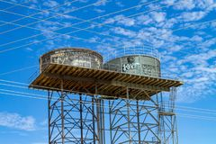 Water tanks and power lines royalty free stock photo
