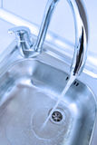 Water tap. And sink in a modern kitchen Stock Image