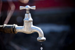 Water tap. Old operational with water running tap Royalty Free Stock Photography