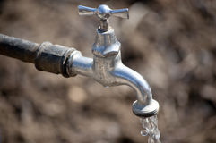 Water tap. Old operational with water running tap Royalty Free Stock Photo