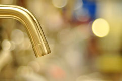 Water-tap. A water-tap in beautiful lights Royalty Free Stock Photo