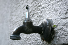 Water tap. A water tap on a house wall Royalty Free Stock Image