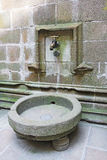 Water tap in abbey Mont Saint Michel Stock Images
