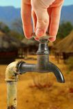 Water tap in africa village Stock Photo
