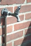 Water tap attached to a brick wall Royalty Free Stock Photography