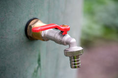 Water tap. On a water barrel in the garden Stock Images