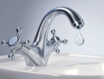 Water tap with big drop of water Royalty Free Stock Image