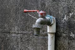 The water tap and cement wall stock images