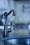 Water tap with  dripping water, shortage of water Royalty Free Stock Photo