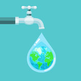 Water tap with the Earth globe inside water drop on blue  Stock Photo