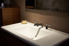 Water tap faucet. With hot and cold water Stock Photo